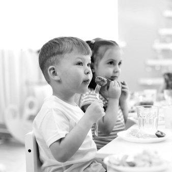 two kids listening