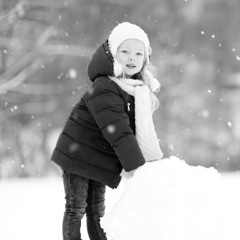 girl playing on a snow