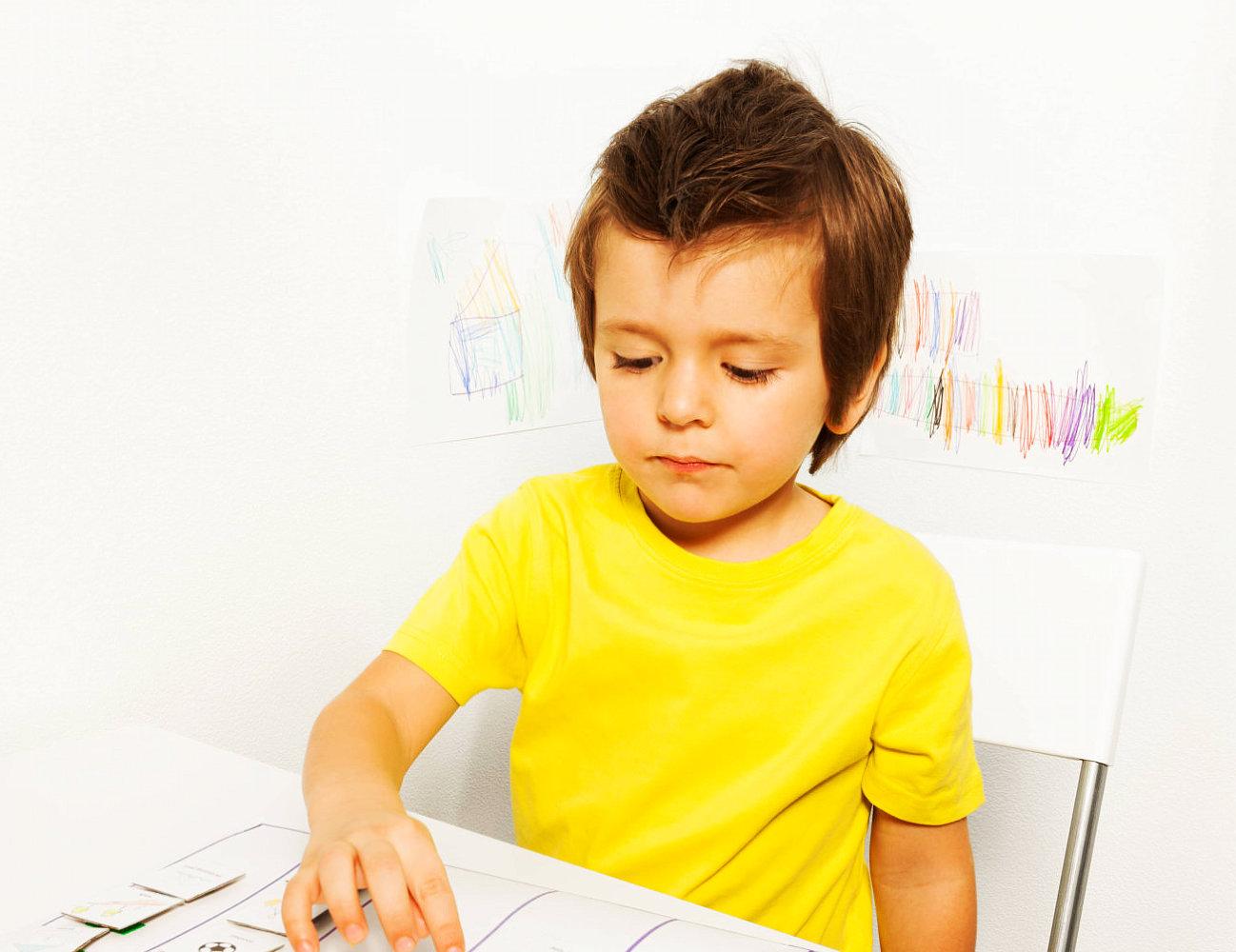 boy wearing yellow shirt