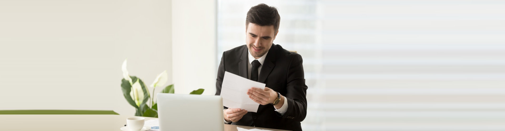 a man holding a paper