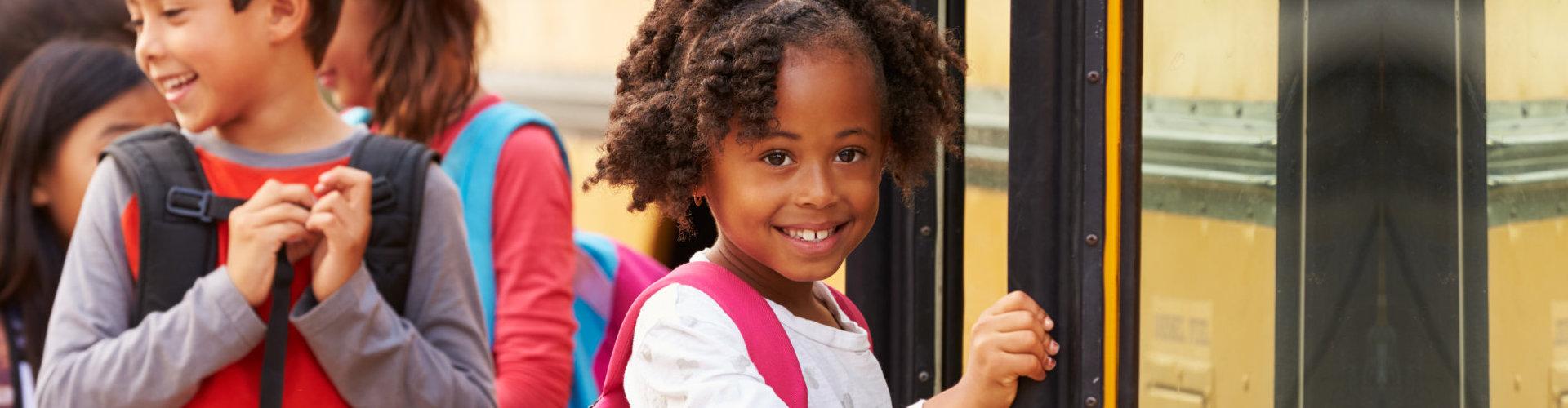 girl entering a bus
